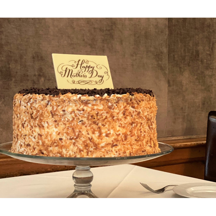 Indulge Mom with our new, exclusive Mother's Day Delight Cake. The beautifully-crafted 12-layer chocolate-coconut cake is filled with coconut custard and rich chocolate ganache, hand-finished with cream cheese icing enveloped in freshly toasted coconut and topped with chocolate shavings.