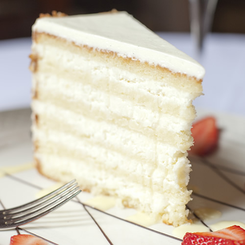 The beloved 12-layer Peninsula Grill Ultimate Coconut Cake is baked fresh daily and shipped across the United States via overnight delivery.